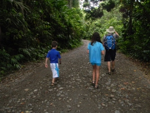 Chris, Kara, and Tristan walking through Manuel Antonio National Park
