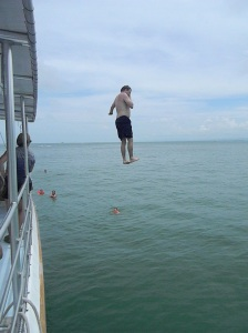 Chris jumping off the roof of our catamaran