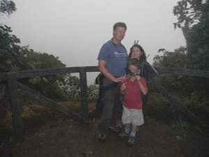 "Chris, Kara, and Tristan at a look out point in Monteverde Biological Reserve. Do you see why it's called a ""cloud forest""?"