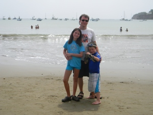 Chris and the kids enjoying the beach at San Juan del Sur, Nicaragua.