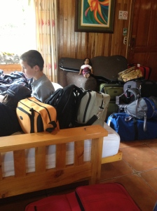 At los Pinos cabins with our luggage, waiting for our taxi to take us to our new home.