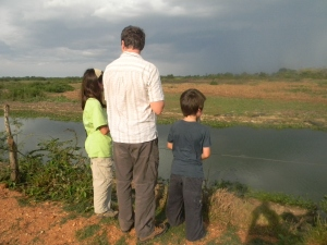 The kids and Chris on the road from Cuiaba to Southwild Pantanal Lodge.