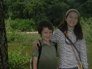 Kara and Tristan at Southwild Pantanal Lodge with capybara in the background.