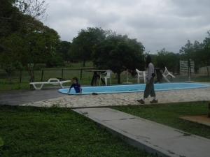 Kara and Tristan at the pool of Southwild Pantanal Lodge.
