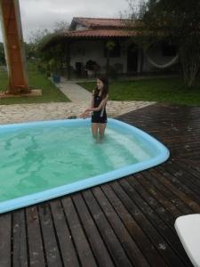 Kara at the pool of Southwild Pantanal Lodge.