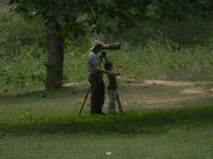 Chris and Tristan photographing at Southwild Pantanal Lodge. There is a bit of a difference in their camera sizes...