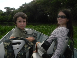 Kara and Tristan boating through a channel.