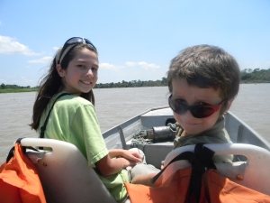 """Kara and Tristan on the boat from Port de Joffre to Southwild Jaguar """"Flotel""""."""